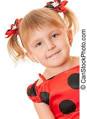 Girl in red polka dot dress