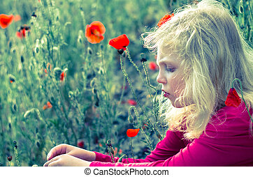 girl in red poppy flower meadow