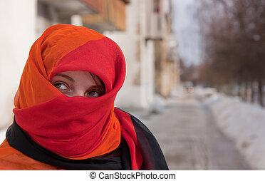 girl in red purdah - young beautiful woman in red purdah...