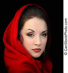 Girl in red scarf - Young woman in a red scarf on black
