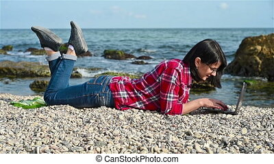 Girl in red shirt with laptop