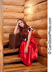 Girl in red spanish dress sitting on stairs