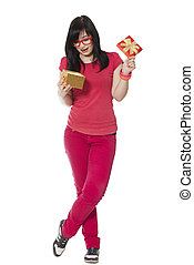 girl in red with present box at white background.