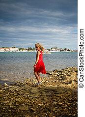 girl in rocky shore