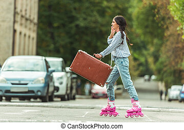 girl in roller skates with suitcase