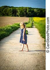 girl in rural path