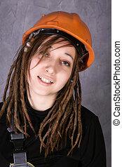 girl in safety helmet orange vest holding hammer tool....