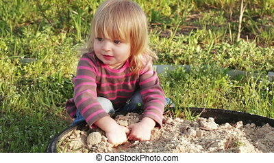 Girl in sandbox