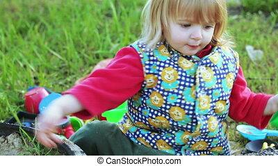 Girl in sandbox