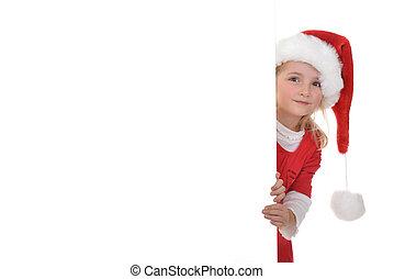 girl in santa cap - little girl in red santa hat peeking...