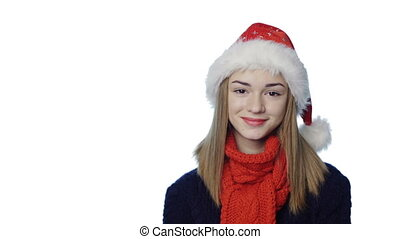 Girl in Santa hat - Closeup portrait of smiling girl wearing...