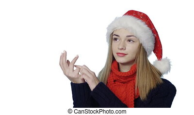 Girl in Santa hat counting fingers - Closeup portrait of...