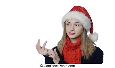Girl in Santa hat counting fingers