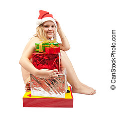 Girl in santa hat sitting naked with Christmas gifts