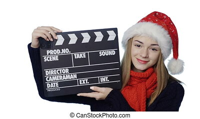 Girl in Santa hat - Smiling girl wearing Santa hat with...