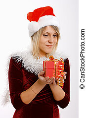 girl in santa hat with a gift