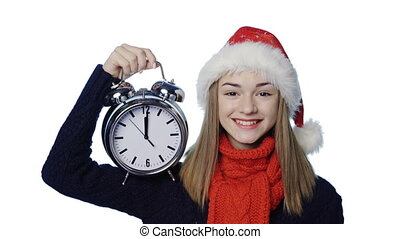 Girl in Santa hat with alarm clock counting fingers