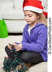 Girl In Santa Hat With Fairy Lights