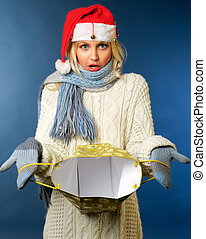 Girl in santa hat with gift bag