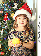 girl in Santa's cap with - girl in a Santa's cap with a ...