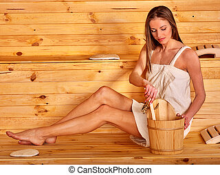 Girl in sauna. - Young woman in  wooden sauna.