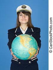 Girl in sea uniform with globe