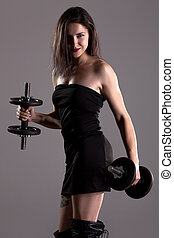 girl in sexy black dress lifting weights