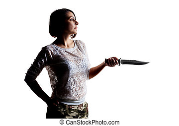 girl in shadow with a large knife