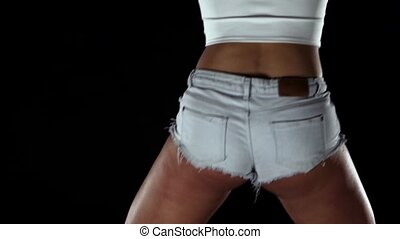 Girl in shorts and top dance. Black. Slow motion