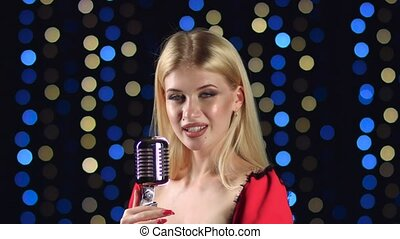 Girl in singing in retro microphone hilarious song. Side...