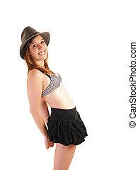 Girl in skirt and bra.