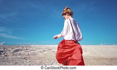 Girl in skirt fluttering in the wind