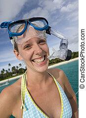 Girl in snorkel gear near a tropical beach in Fiji
