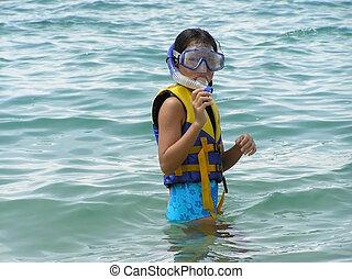 girl in snorkling gear