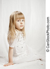 Girl in snowflake costume on white background