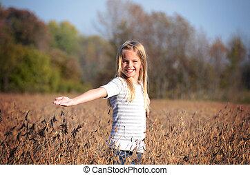 girl in soybean field