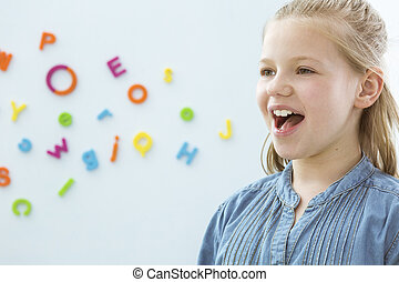 Girl in speech therapy office - Copy space with little girl...
