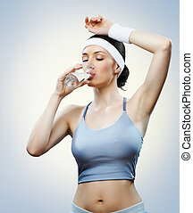 girl in sport - Athlete drinking water