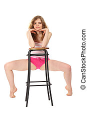 Girl in sportswear leans against bar stool