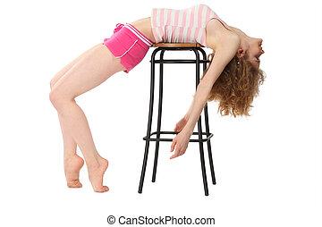 Girl in sportswear lies on bar stool