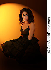 Girl in spotlight - Dramatic portrait of a beautiful girl on...