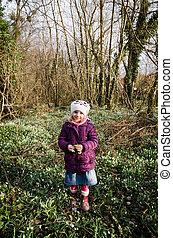 girl in spring meadow