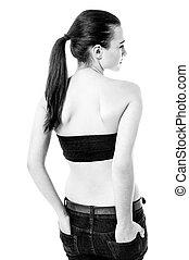 Girl in strapless attire looking sideways
