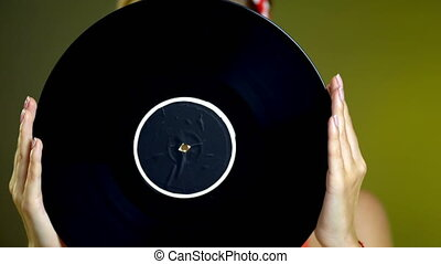 Girl in style holding vinyl record. - Girl in pin-up style...
