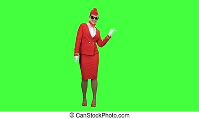 Girl in sunglasses is dancing. Green screen