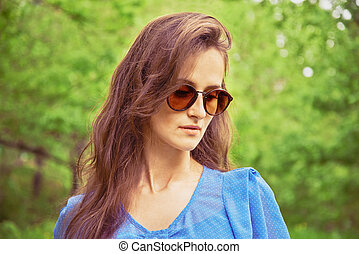 Girl in sunglasses outdoor