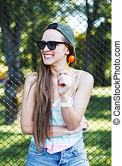 Girl in sunglasses with lollipop