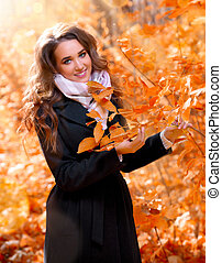 Girl in sunny autumn forest