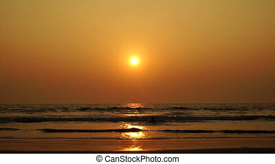 Girl in sunset sea.