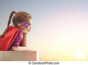 girl in Superhero's costume - Little child girl plays ...